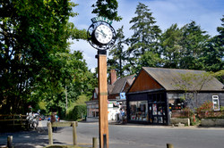 Village clock with signage
