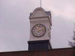 Gold skeleton clock on tower