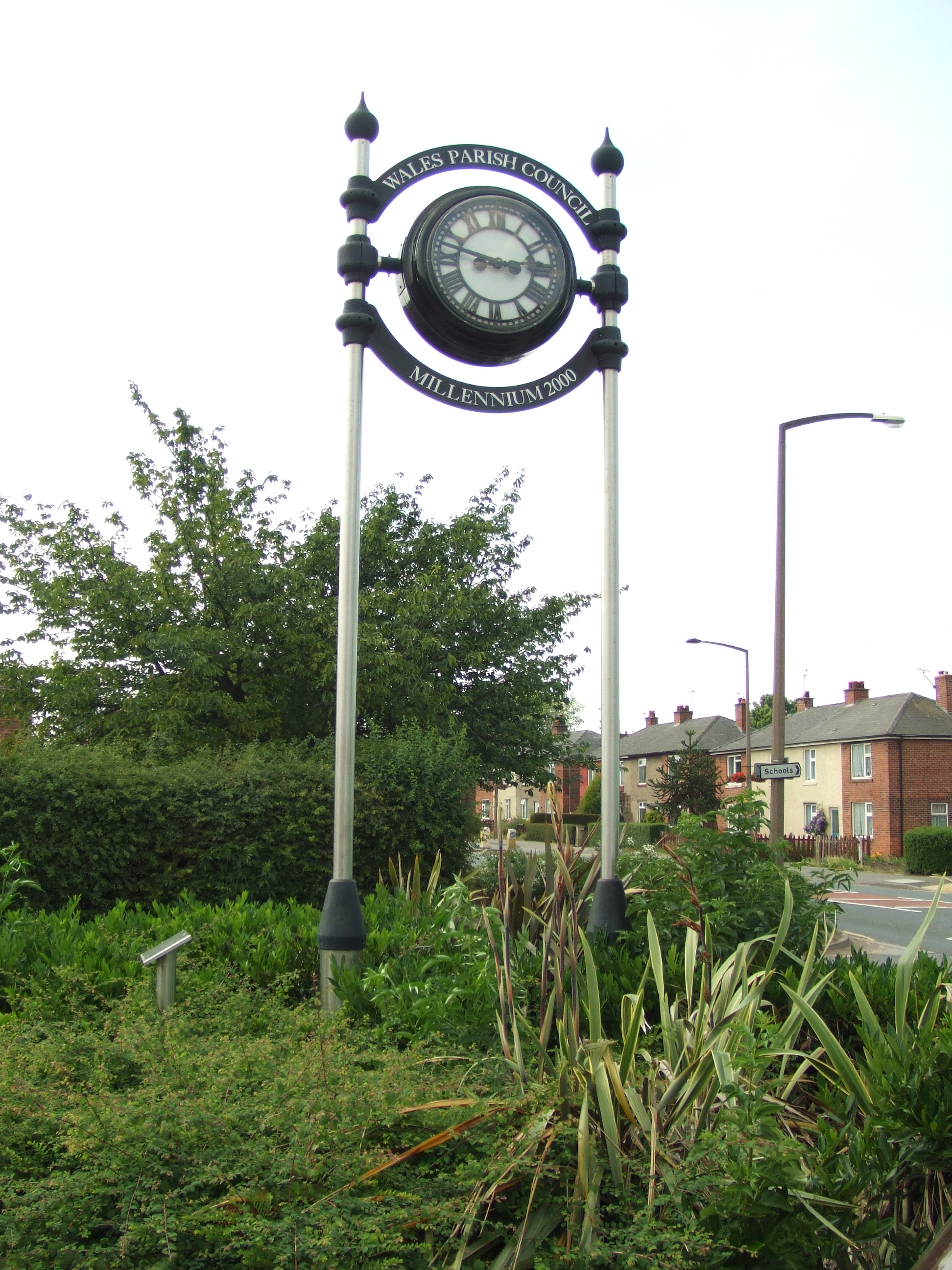 Double sided clock on two posts