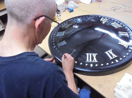 Outdoor clock restoration and gilding