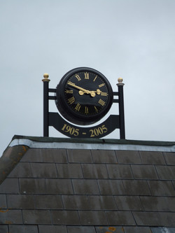 Double sided clock on a roof