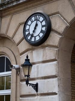 Skeleton clock in a bezel