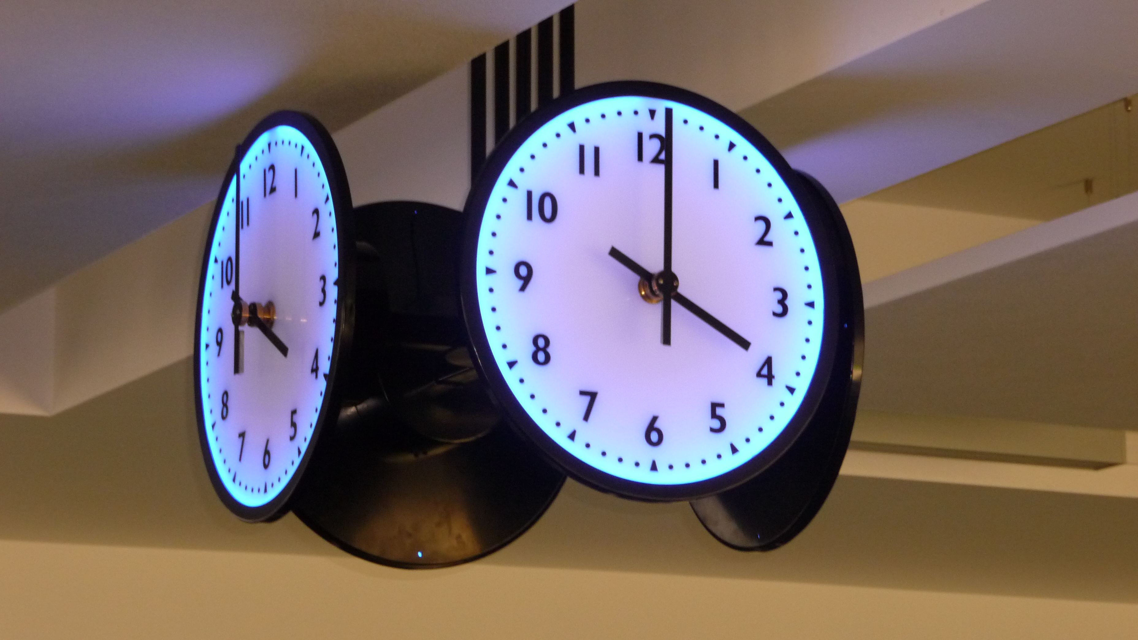 Suspended four sided clock