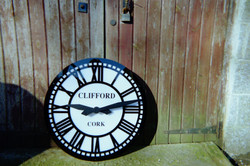 Skeleton style outdoor clock with sign writing