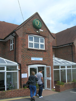 Bezel clock above college entrance