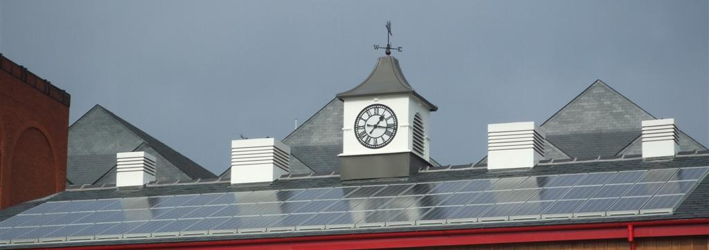 Clock tower above a coach station