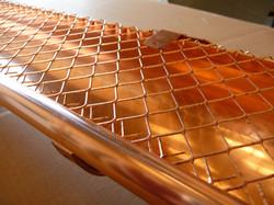 Copper leaf guard on gutter