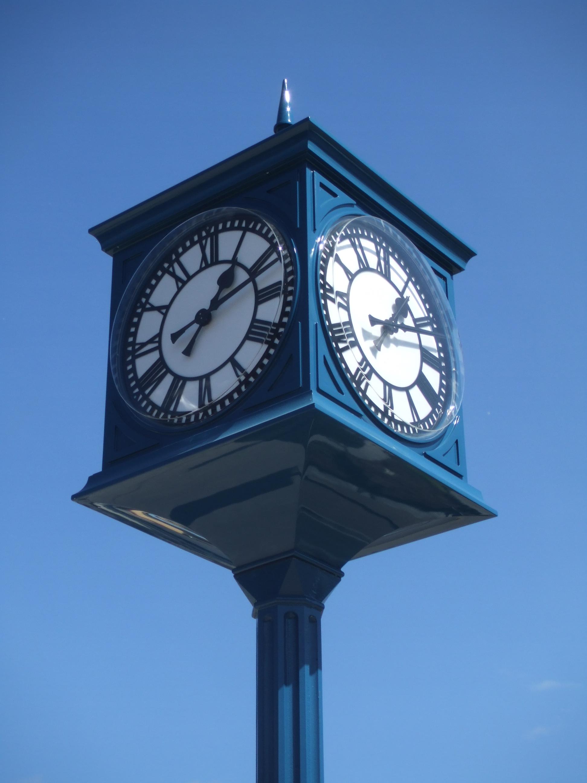 Four sided pillar clock