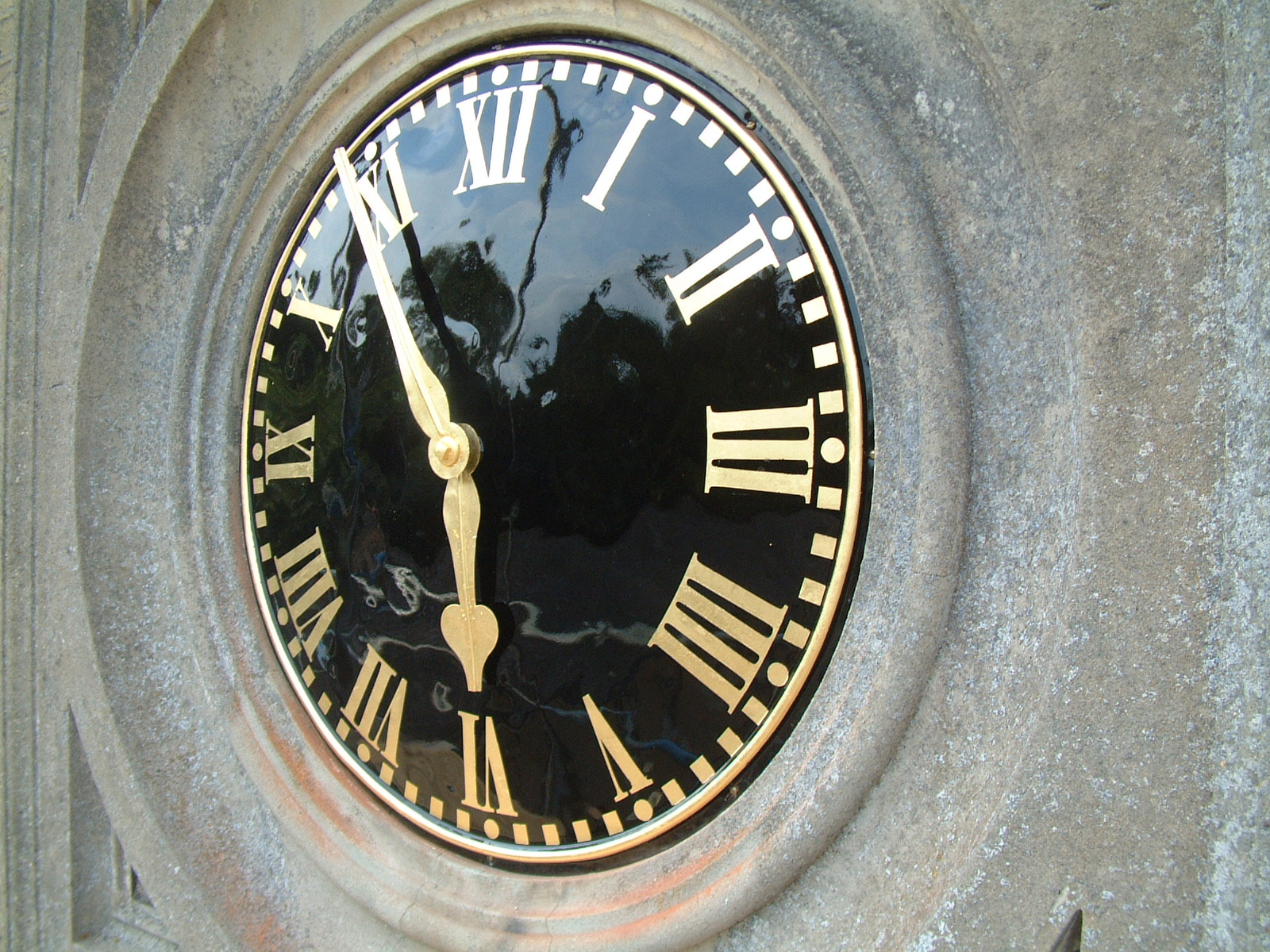 Black and gold exterior clock