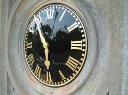 Black and gold exterior clock