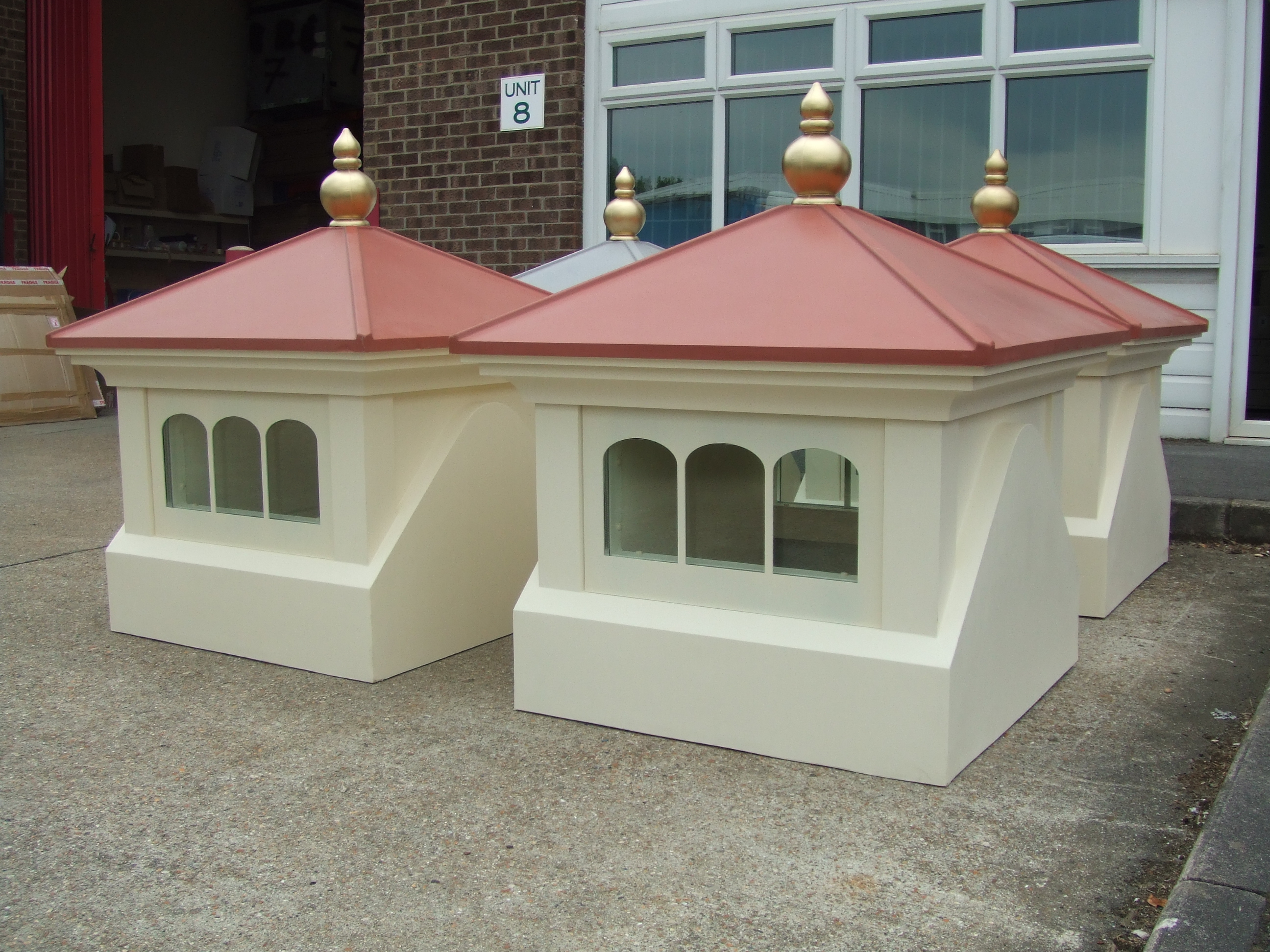 Glazed cupolas with gold finials