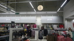 Suspended clock in clothes shop