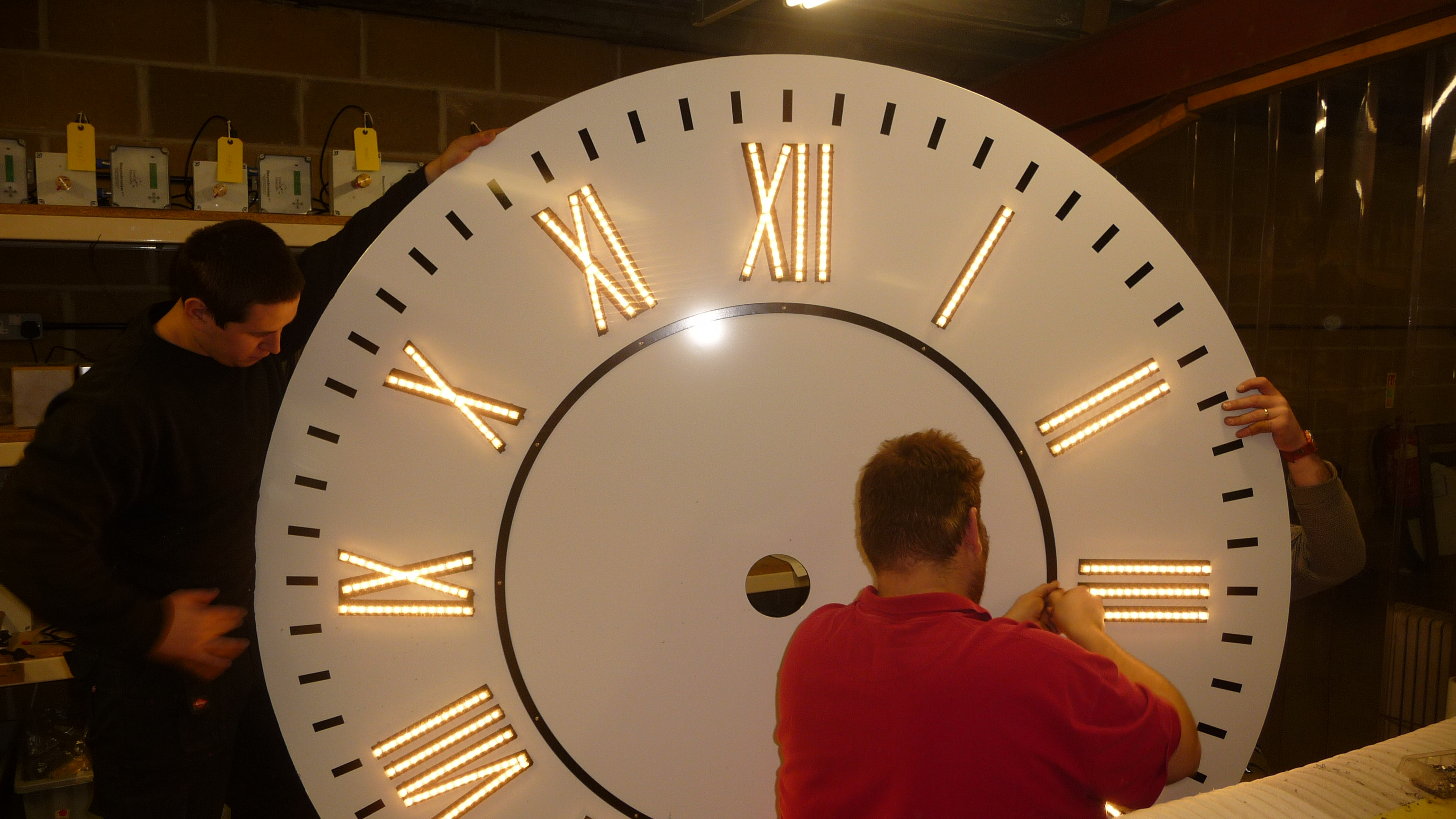 Fitting lighting on clock face