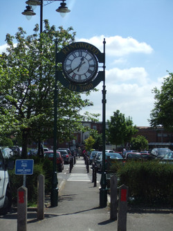 Double sided clock over pavement