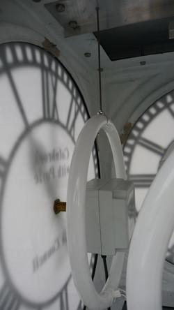 Lighting in a pillar clock
