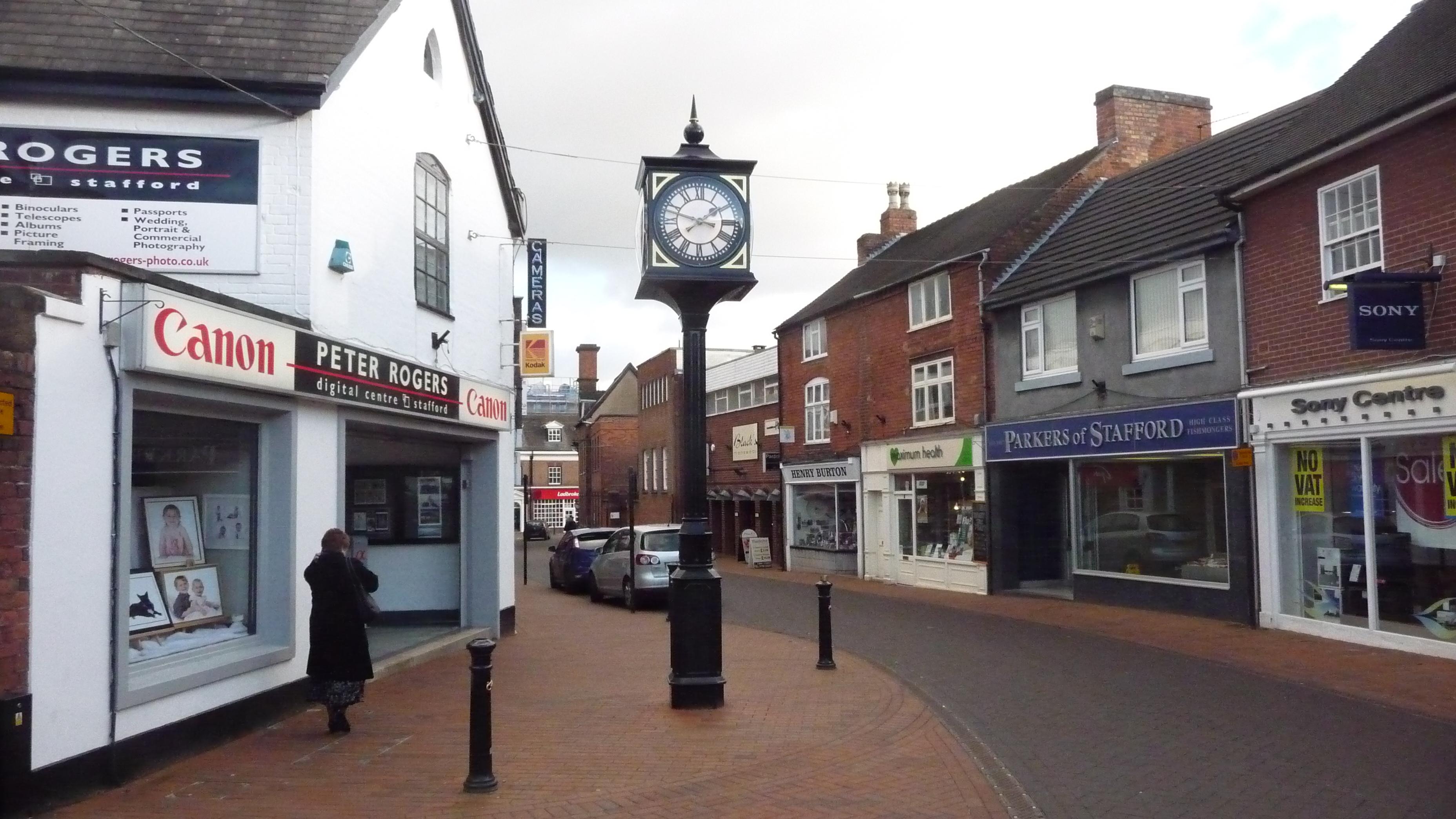 Pillar clock outside shops