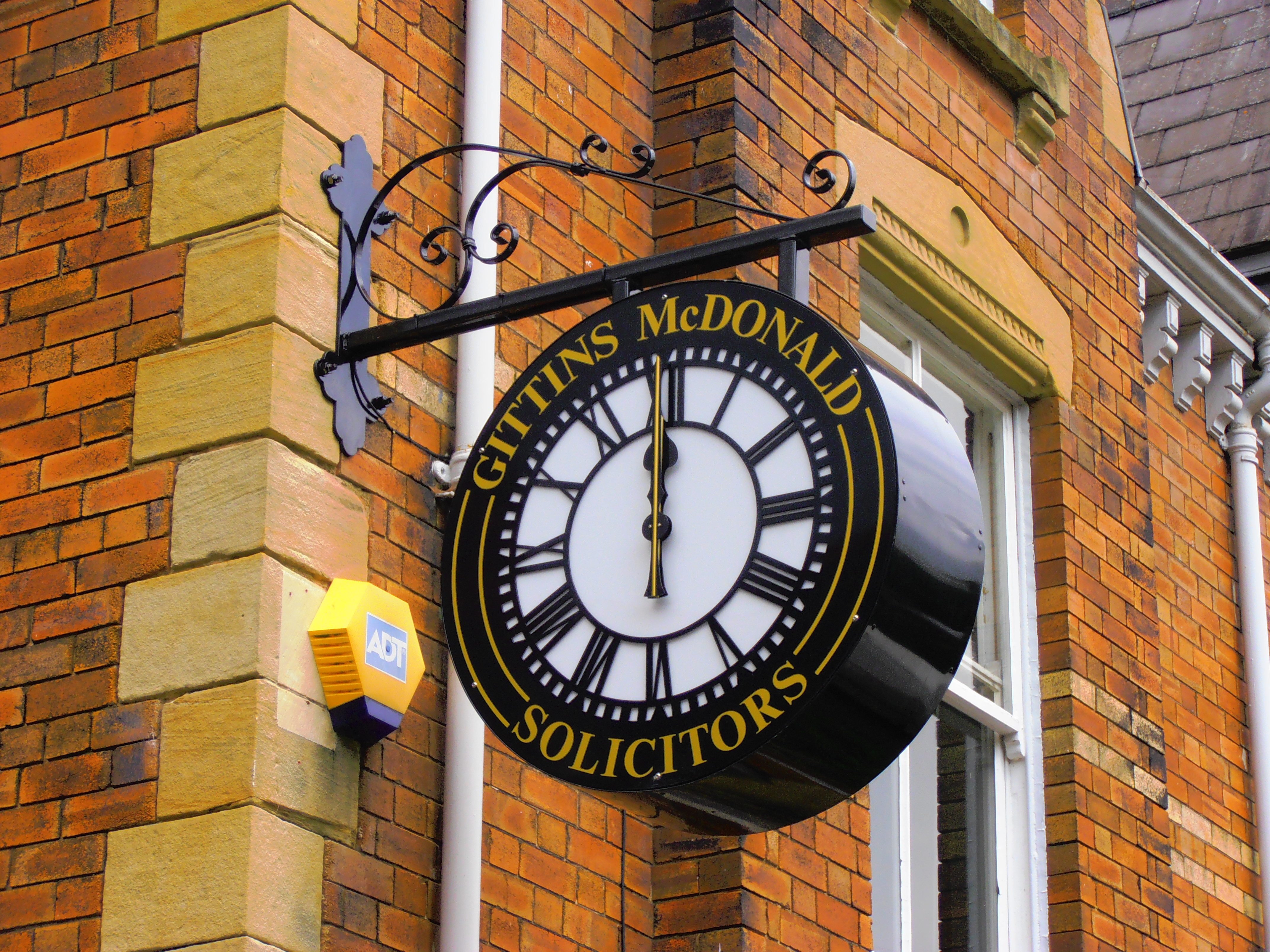 Drum clock advertising company name