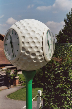 Two sided clock for golf course
