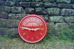 Sign written red exterior clock