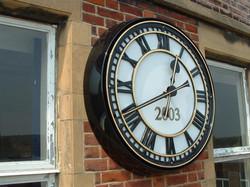 Skeleton bezel clock with date