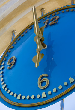 Blue clock with gold numerals