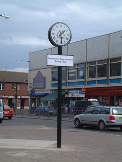 Clock and sign