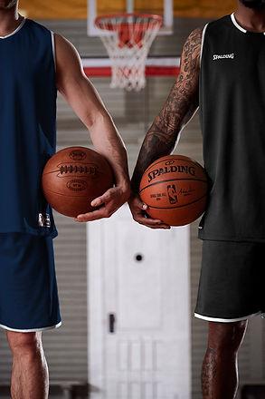 Basketball players with Spalding basketball