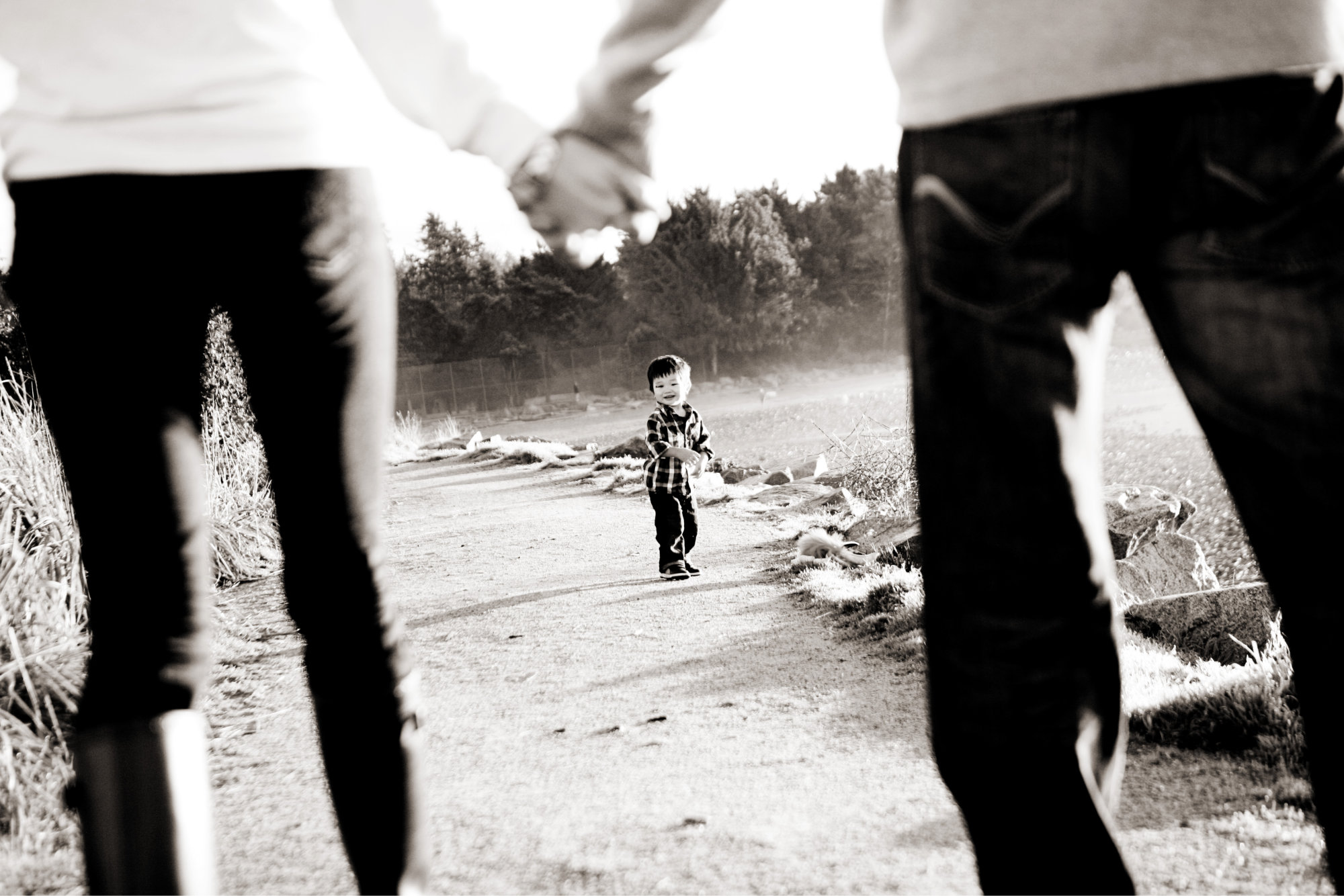 Slider 1 - boy with parents holding hands