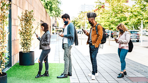 young-people-waiting-line-practising-social-distancing-city-shop.jpg