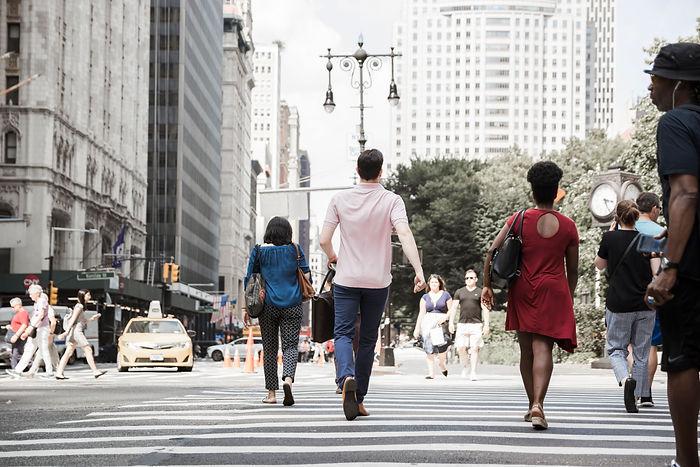 man-crossing-road-busy-street.jpg