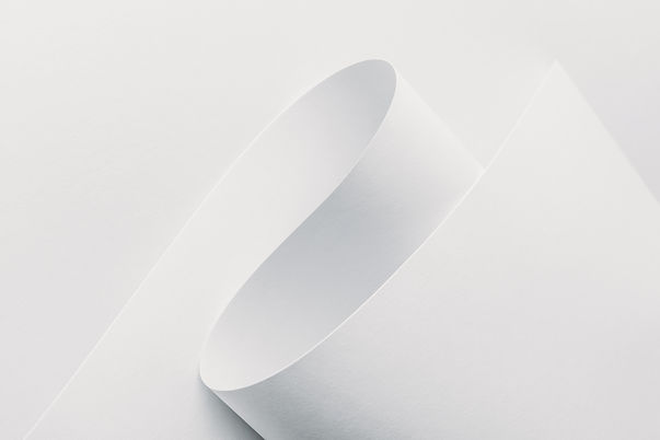 close-up-view-of-white-rolled-paper-on-white-backg-4U9YHZJ.jpg