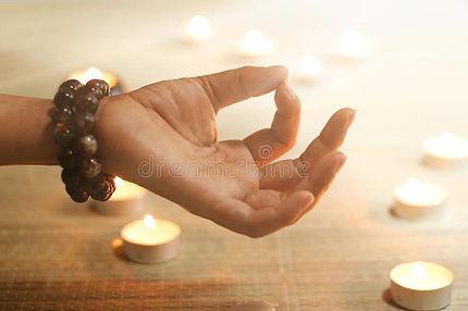 woman-hand-yoga-meditation-candle-warm-g