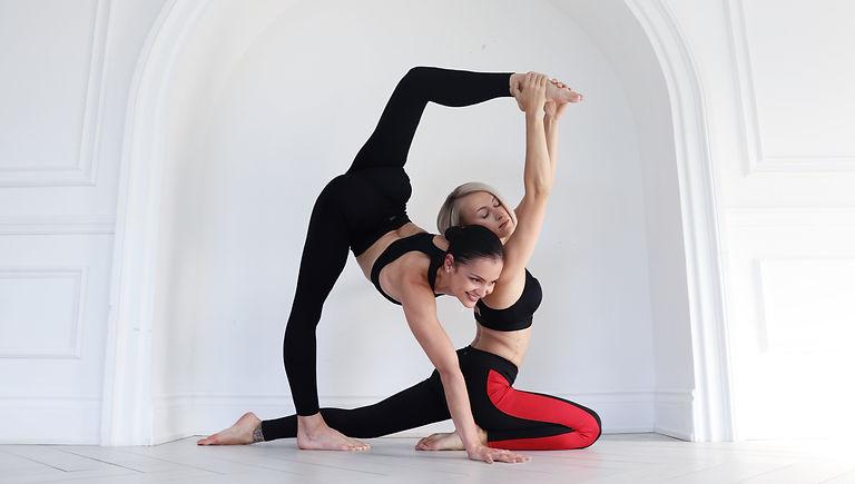 Zhana and Jemma Stretching in Studio
