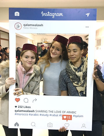 Arabic students pose with a Qalam frame