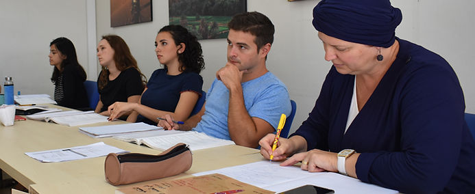 Expats, students, and professionals study Arabic in the evening