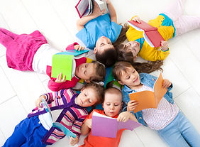 Group of children enjoying reading toget