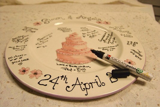 signature wedding plate with wedding cake on