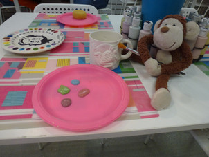 Crafty Monkey painting pottery