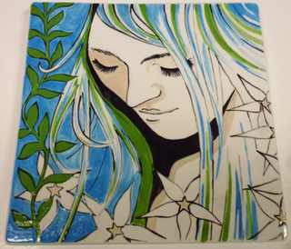 Girls face painted on a tile
