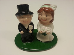 pottery bride and groom wedding cake topper