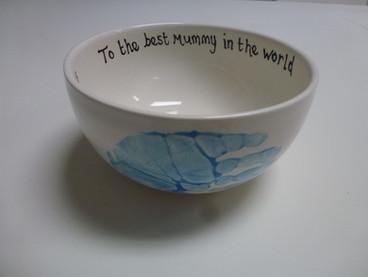 handprint on pottery bowl