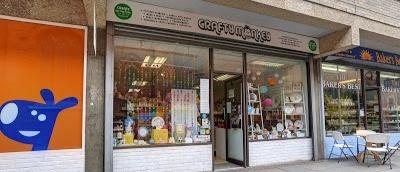 Crafty Monkey shop front inbetween Pets Corner and Bakers Best