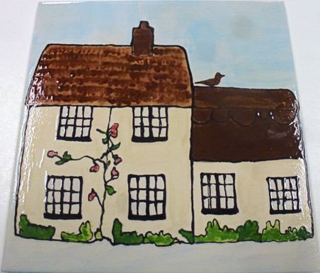 cottages painted onto a tile