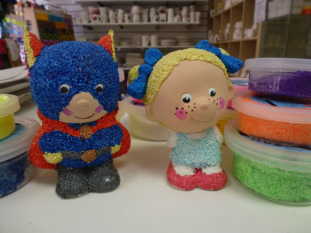 Superman and young girl with foam clay pots