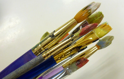 Paintbrushes with paint on
