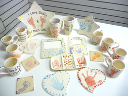 selection of pottery with hand and footprints on for dad