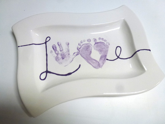 love plate with hand and footprints