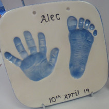 Baby hand and footprint clay impression