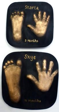 Gold on black plaster outprints