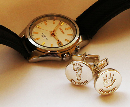 cufflinks with hand and footprints